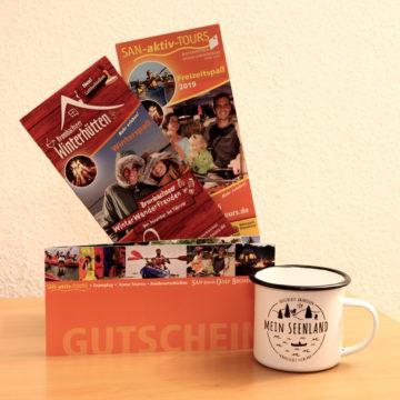 Geschenkset SAN-aktiv-Tours / SAN-Shine-Camp + MeinSeenland Emailletasse